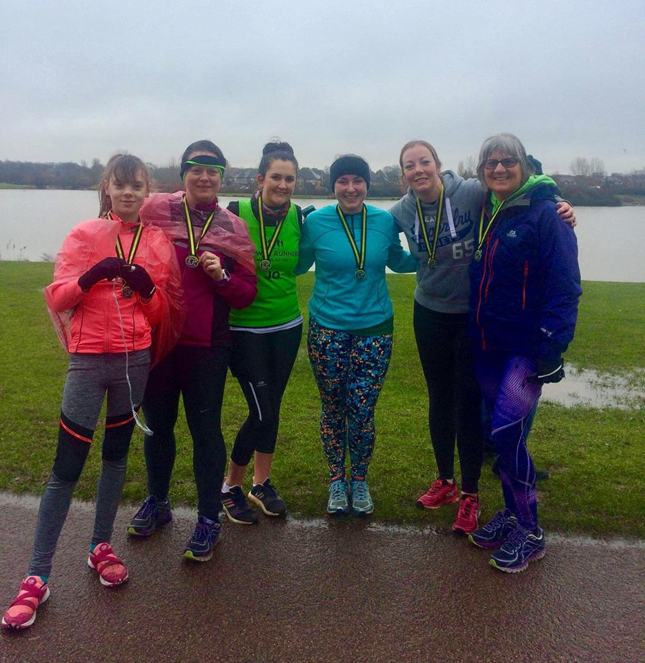 6 women stood with medals and in running kit