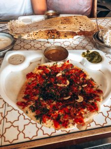 A tomato and cashew pitta with a dosa and dips