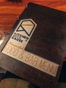 A large menu from kitchen with a cause