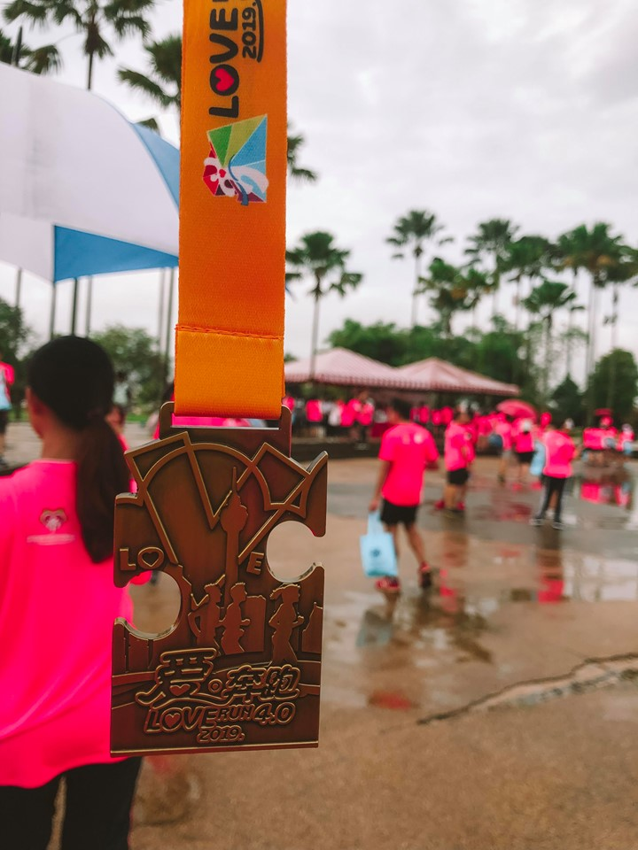 Love Run 4.0 medal. Shaped in a puzzle piece so each year it all links together. There is one more year to go.