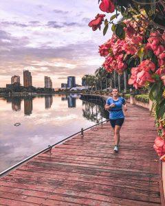 girl running next to lake