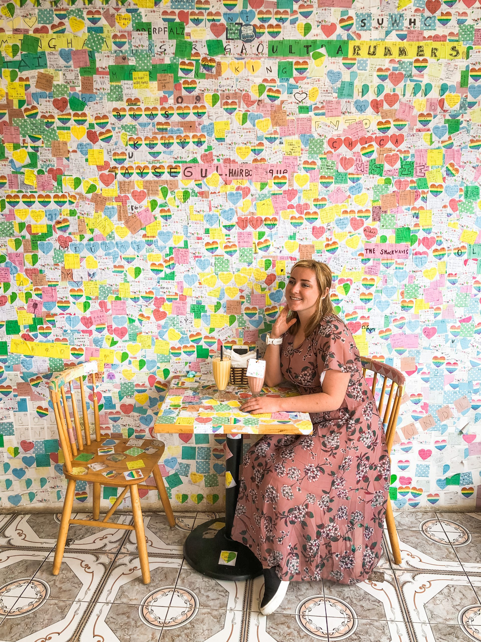 Girl sat in front of a room of post it notes