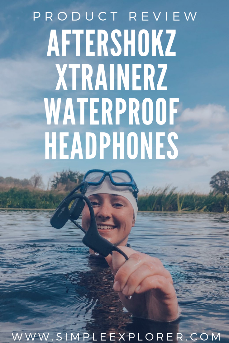 AFTERSHOKZ XTRAINERZ WATEPROOF HEADPHONES REVIEW. title over picture of girl in water holding headphones