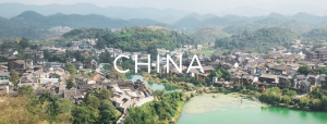 a picture of houses, mountains and lakes with china text over the top